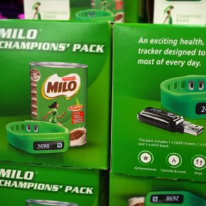 Example of diet culture for kids: a stack of boxes containing Nestle Milo branded activity trackers for children